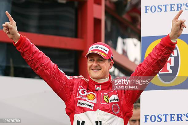 German Ferrari driver Michael Schumacher jubilates on the podium of the SpaFrancorchamps racetrack after the Belgium Grand Prix 29 August 2004 in...