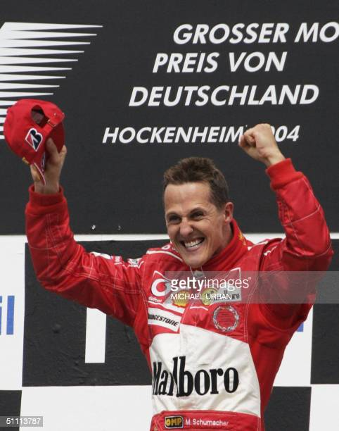 German Ferrari driver Michael Schumacher jubilates on the podium of the Hockenheim racetrack at the end of the German Grand Prix 25 July 2004 in...