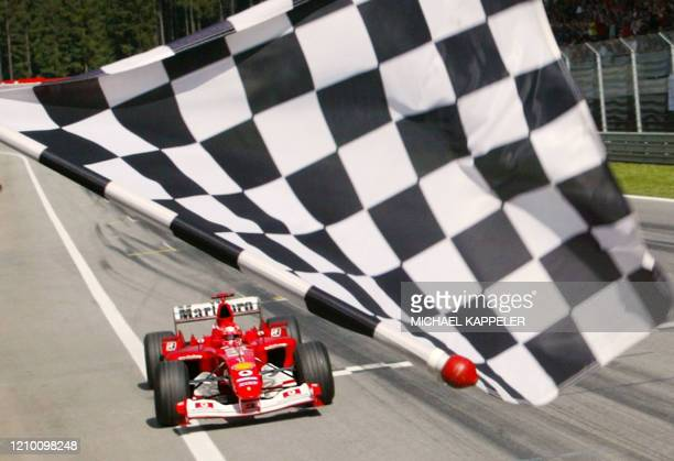 German Ferrari driver Michael Schumacher passes the finish line of the Spielberg racetrack 18 May 2003 at the end of the Austrian Formula One Grand...