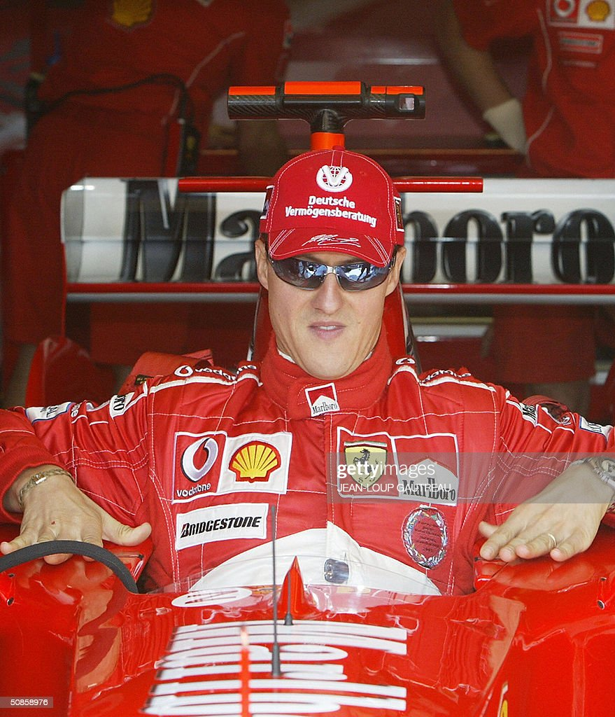 German Ferrari driver Michael Schumacher sits in his car in the pits of the Monte-Carlo racetrack during the first free practice session three days before the Monaco Grand Prix, 20 May 2004 in Monaco.