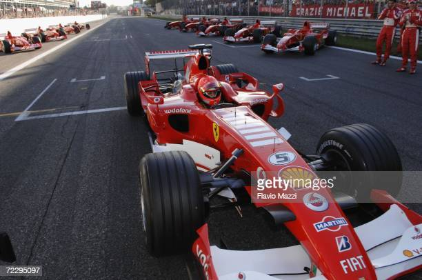German Ferrari driver Michael Schumacher sits in the cockpit of his car on the grid before the start of a show race with his teammates during the...