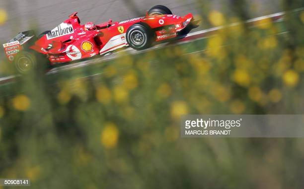 German Ferrari driver Michael Schumacher steers his car on the Nurburgring racetrack during the fourth free practice session on the eve of the Grand...