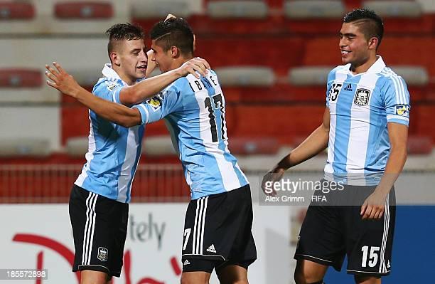 German Ferreyra of Argentina celebrates his team's second goal with team mates Joaquin Ibanez and Rodrigo Moreira during the FIFA U-17 World Cup UAE...