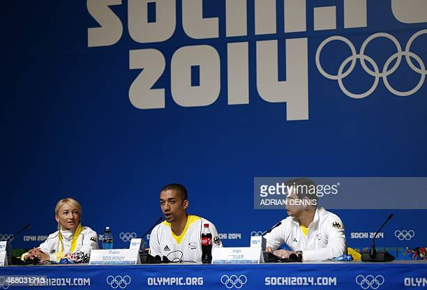 German figure skater Aliona Savchenko Robin Szolkowy and coach Ingo Steuer give a press conference at the Main Media Center in Sochi on February 9...