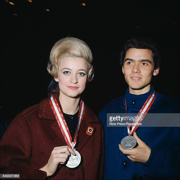 German figure skaters Marika Kilius and HansJurgen Baumler pictured together with their Olympic silver medals for pair skating awarded at the 1964...