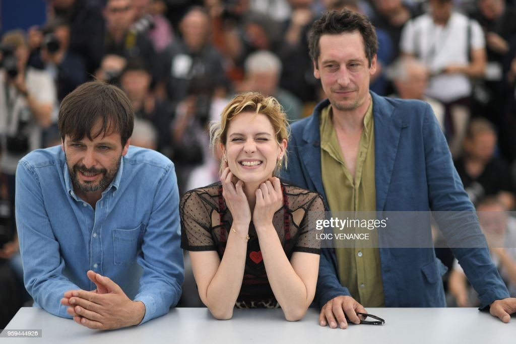 German film director Ulrich Koehler, Italian actress Elena Radonicich and German actor Hans Loew pose on May 17, 2018 during a photocall for the film 'In My Room' at the 71st edition of the Cannes Film Festival in Cannes, southern France.