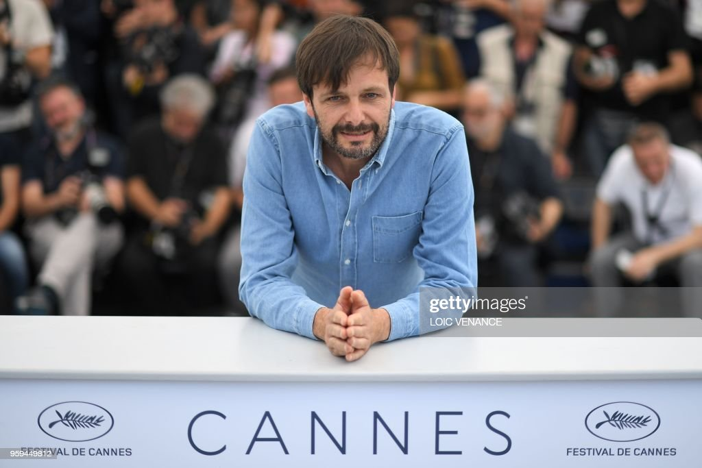 German film director Ulrich Koehler poses on May 17, 2018 during a photocall for the film 'In My Room' at the 71st edition of the Cannes Film Festival in Cannes, southern France.