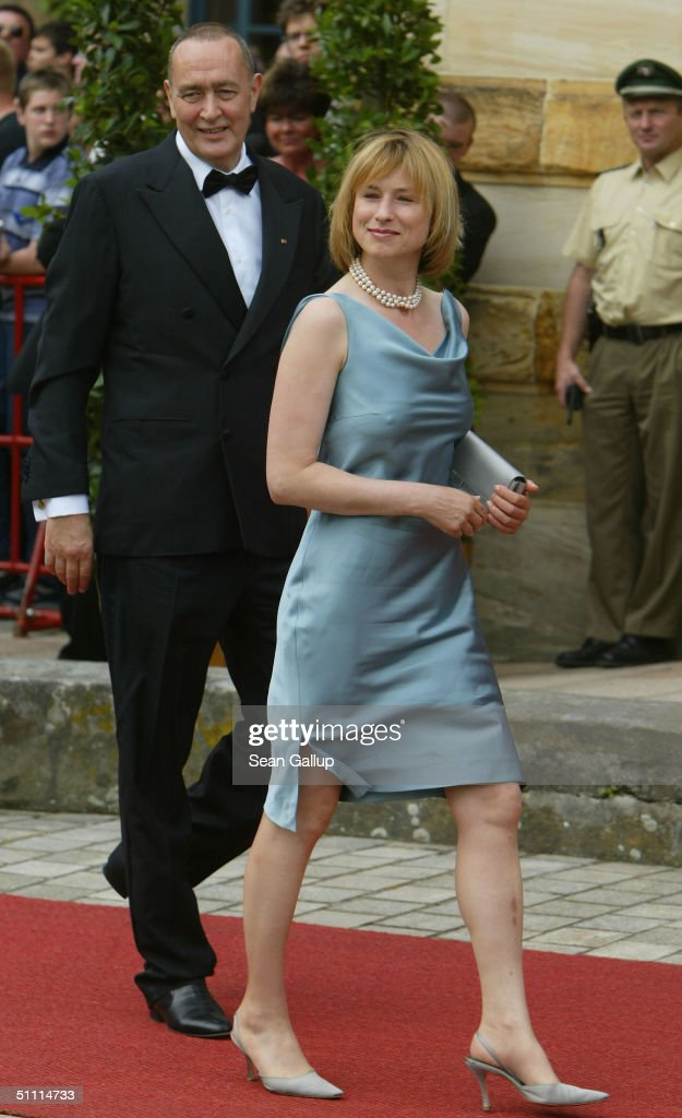 German film producer Bernd Eichinger and friend Corinna Harfouch arrive for the opening performance of Richard Wagner's 'Parsifal' July 25, 2004 on the first day of the 93rd Richard Wagner Festival in Bayreuth, Germany.