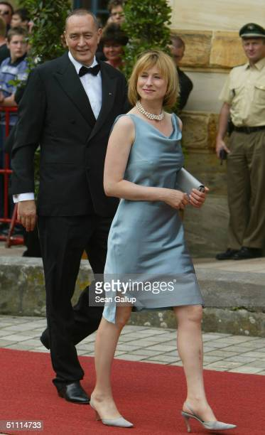 German film producer Bernd Eichinger and friend Corinna Harfouch arrive for the opening performance of Richard Wagner's Parsifal July 25 2004 on the...