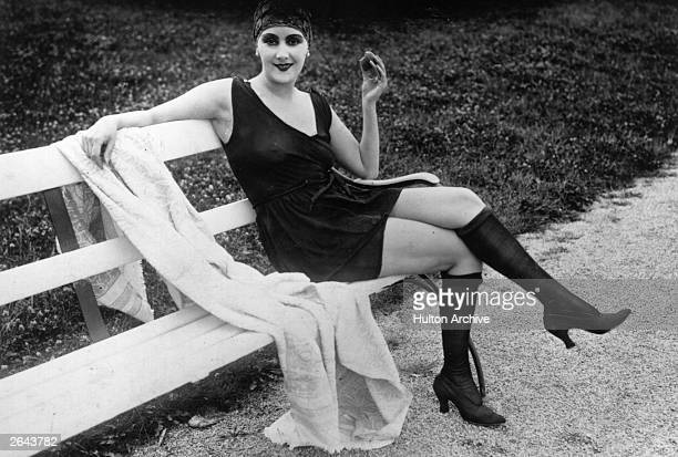 German film star Lil Dagover wearing a swimming costume with stockings