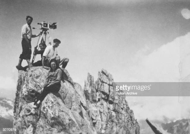 German filmmaker and actress Leni Riefenstahl with a camera and film crew on the summit of Mont Blanc