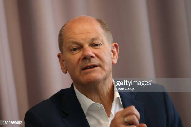 German Finance Minister and chancellor candidate of the German Social Democrats Olaf Scholz speaks to members of the Foreign Journalists' Association...