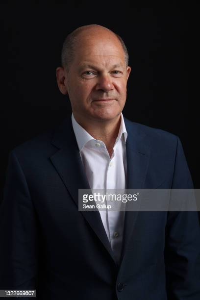 German Finance Minister and chancellor candidate of the German Social Democrats Olaf Scholz poses for a brief portrait before speaking to members of...