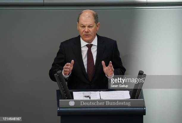 German Finance Minister and Deputy Chancellor Olaf Scholz speaks at the Bundestag prior to a vote and the likely passing of a massive federal...
