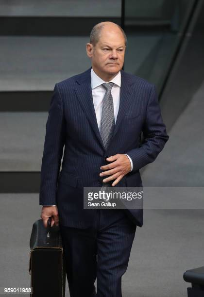 German Finance Minister and Vice Chancellor Olaf Scholz arrives for debates at the Bundestag over the federal budget on May 16 2018 in Berlin Germany...