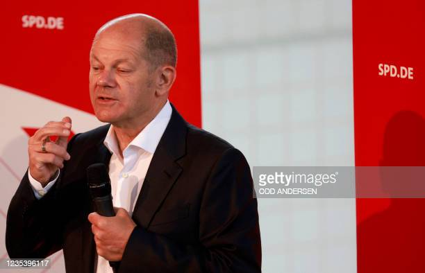 German Finance Minister and Vice-Chancellor and also candidate for Chancellor of Germany's social democratic SPD party Olaf Scholz addresses guests...