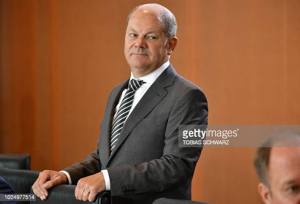 German Finance Minister and ViceChancellor Olaf Scholz arrives for the weekly cabinet meeting in Berlin on August 29 2018