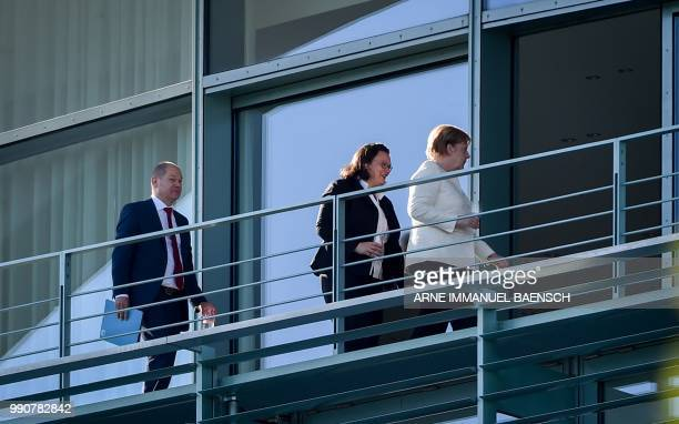 German Finance Minister and ViceChancellor Olaf Scholz leader of the Social Democratic Party Andrea Nahles and German Chancellor and leader of the...