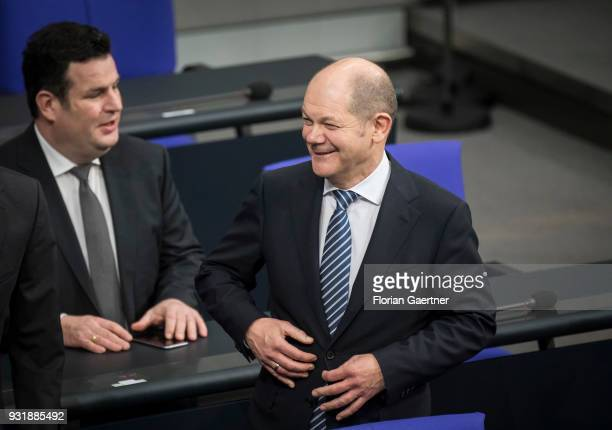 German Finance Minister Olaf Scholz and German Minister of Work and Social Issues Hubertus Heil are pictured before the swearingin ceremony of the...