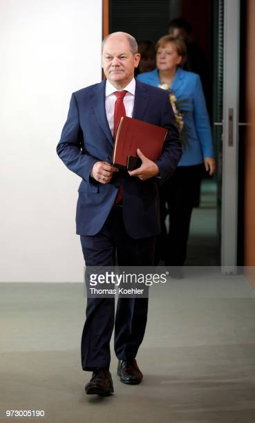 German Finance Minister Olaf Scholz arrives for the Weekly Government Cabinet Meeting on June 13 2018 in Berlin Germany