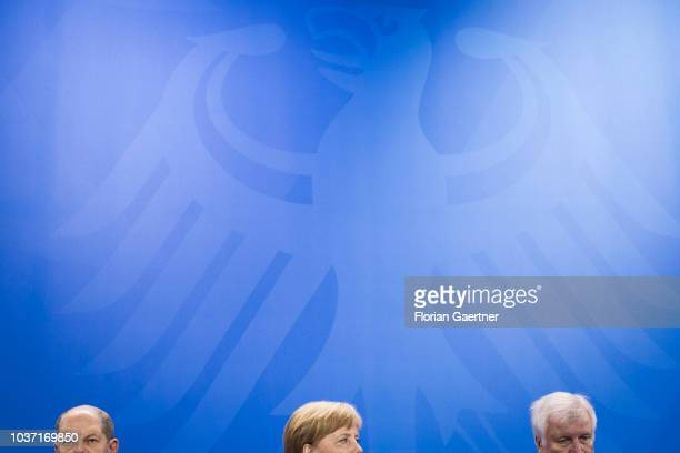 German Finance Minister Olaf Scholz German Chancellor Angela Merkel and German Interior Minister Horst Seehofer are pictured during a press...