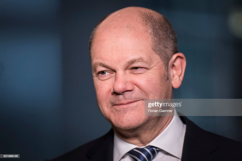 German Finance Minister Olaf Scholz Is Pictured During A Tv Interview On March