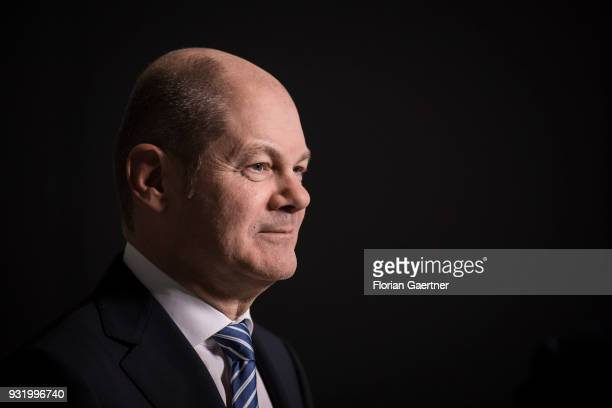 German Finance Minister Olaf Scholz is pictured during a tv interview on March 14 2018 in Berlin Germany