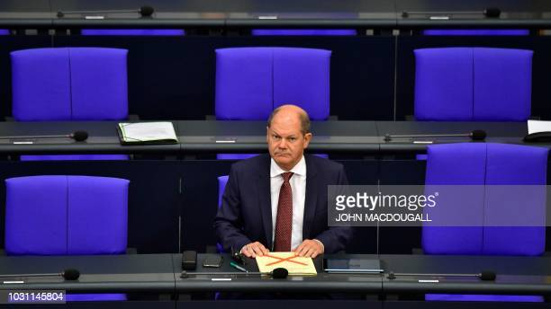 German Finance Minister Olaf Scholz looks on before presenting Germany's budget for 2019 at the Bundestag the lower house of Parliament on September...