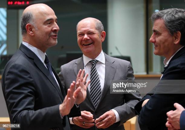 German Finance Minister Olaf Scholz Member of the European Commission in charge of Economic and Financial Affairs Taxation and Customs Pierre...