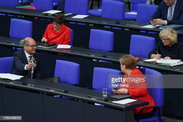 German Finance Minister Olaf Scholz shows Chancellor Angela Merkel the newlyreleased German government CoronaWarnApp Covid19 infection tracing app on...