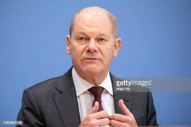German Finance Minister Olaf Scholz speaks at the press conference to present Germany's economic strategy for weathering the upcoming semi-lockdown...