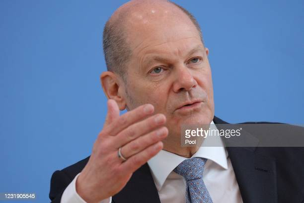German Finance Minister Olaf Scholz speaks to the media about Germany's federal budget for 2022 and projections for the budget to 2025 on March 24,...