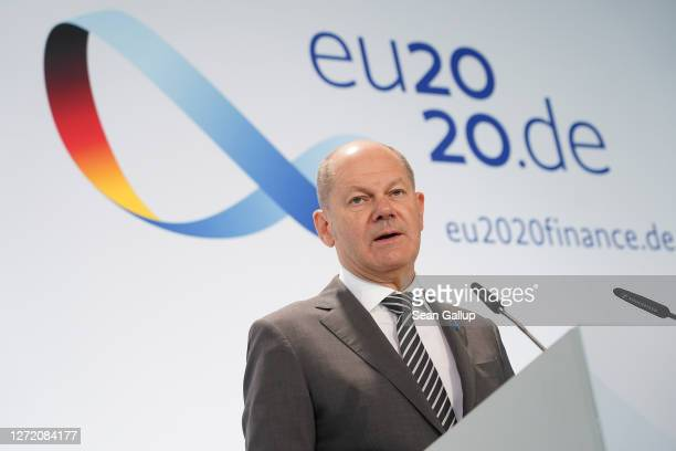 German Finance Minister Olaf Scholz speaks to the media at the conclusion of an informal meeting of European Union ministers for economic and...