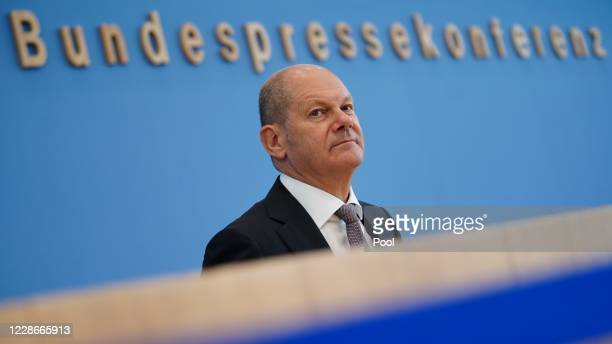 German Finance Minister Olaf Scholz speaks to the media over the federal budget until 2021 as well as finance planning through to 2024 during the...