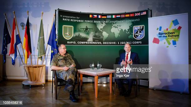 German Finance Minister Olaf Scholz talks in the course of the EUCivil Dialogue together with Brigadier General Dieter Meyerhoff on September 18 2018...