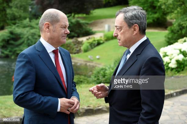 German Finance Minister Olaf Scholz talks with European Central Bank President Mario Draghi during a Eurogroup meeting at Senningen Castle in...