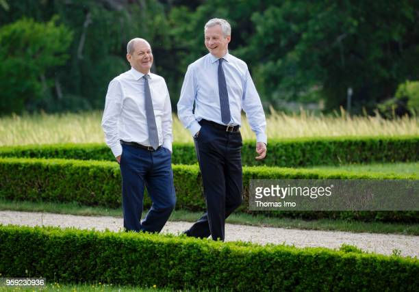 German Finance Minister Olaf Scholz welcomes his French counterpart Bruno Le Maire for talks at the Villa Borsig on May 16 2018 in Berlin Germany The...