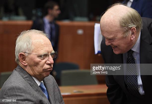 German Finance Minister Wolfgan Schaeuble talks with Irish Finance Minister Michael Noonan before an Eurogroup Council meeting on May 11 2015 at EU...