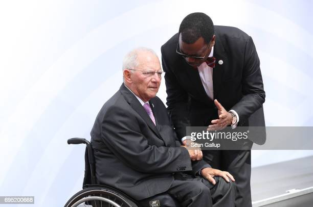 German Finance Minister Wolfgang Schaeuble and Akinwumi Adesina President of the African Development Bank chat following the group photo at the G20...