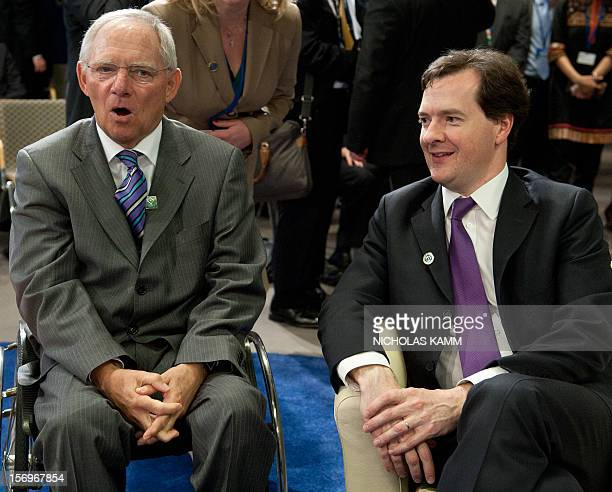 German Finance Minister Wolfgang Schaeuble and Britain's Chancellor of the Exchequer George Osborne chat before the start of the International...