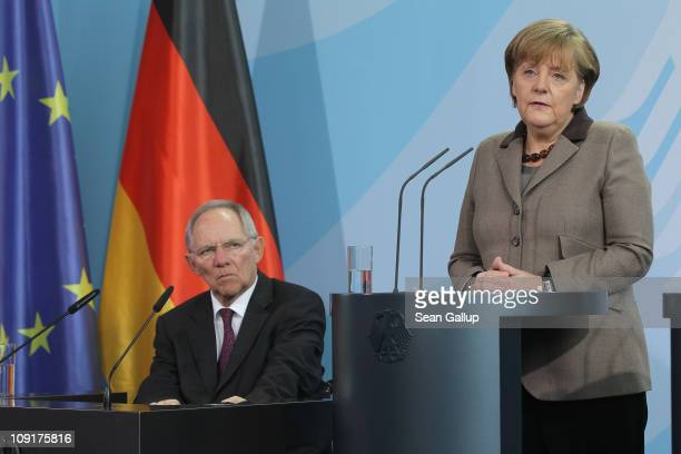 German Finance Minister Wolfgang Schaeuble and Chancellor Angela Merkel speak to the press to announce that Jens Weidmann will become new head of...