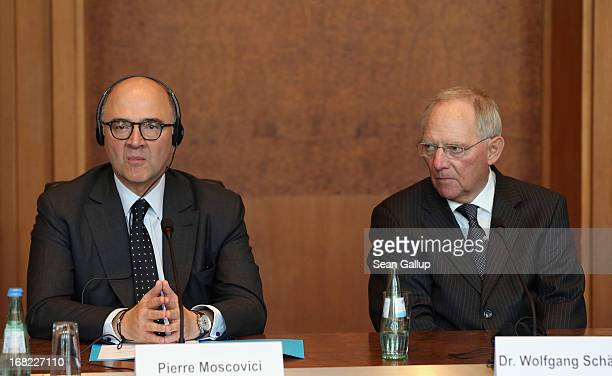 German Finance Minister Wolfgang Schaeuble and French Finance Minister Pierre Moscovici attend a discussion with students during events marking the...