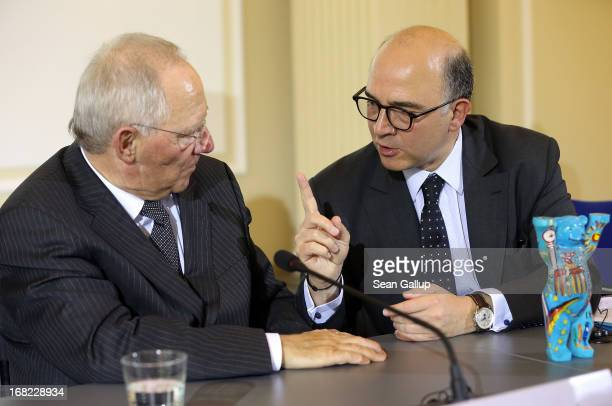 German Finance Minister Wolfgang Schaeuble and French Finance Minister Pierre Moscovici chat after speaking to the media following events marking the...