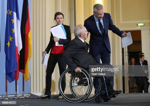 German Finance Minister Wolfgang Schaeuble and new French Finance Minister Bruno Le Maire arrive to speak to the media following talks on May 22 2017...