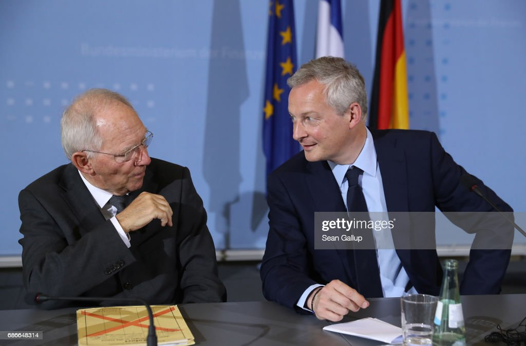 German Finance Minister Wolfgang Schaeuble (L) and new French Finance Minister Bruno Le Maire chat after speaking to the media following talks on May 22, 2017 in Berlin, Germany. The new French government under President Emmanuel Macron is eager to launch both domestic and E.U.-reforms and has sought German help to attain the latter.
