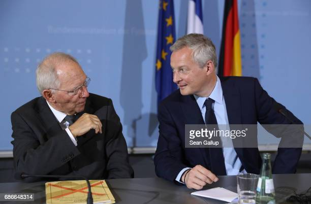 German Finance Minister Wolfgang Schaeuble and new French Finance Minister Bruno Le Maire chat after speaking to the media following talks on May 22...