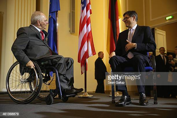 German Finance Minister Wolfgang Schaeuble and US Treasury Secretary Jack Lew arrive to speak to the media following talks at the Finance Ministry on...