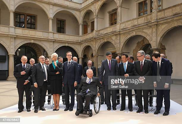 German Finance Minister Wolfgang Schaeuble arrives for the group photo of finance ministers central bank governors and global financial institution...