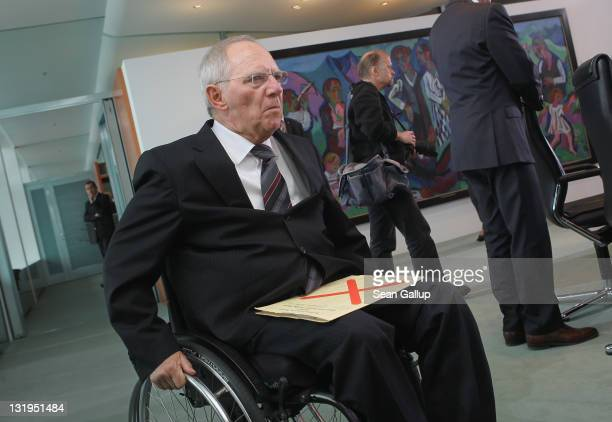 German Finance Minister Wolfgang Schaeuble arrives for the weekly German government cabinet meeting on November 9 2011 in Berlin Germany High on the...