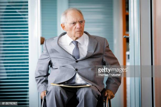 German Finance Minister Wolfgang Schaeuble arrives for the weekly cabinet meeting at the chancellery on July12 2017 in Berlin Germany